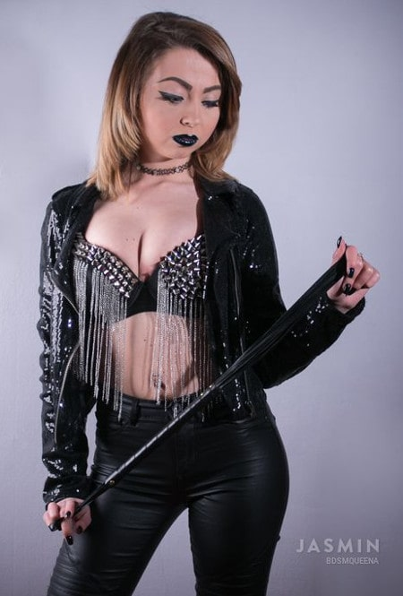 black leather mistress with ass whipping whip
