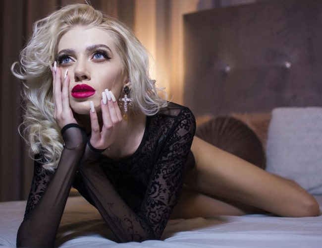 pale blonde domme flaunts legs & long nails