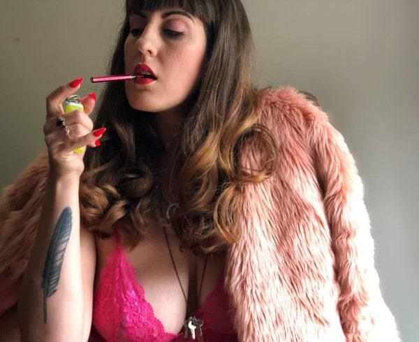 busty mistress smoking & posing in fur coat
