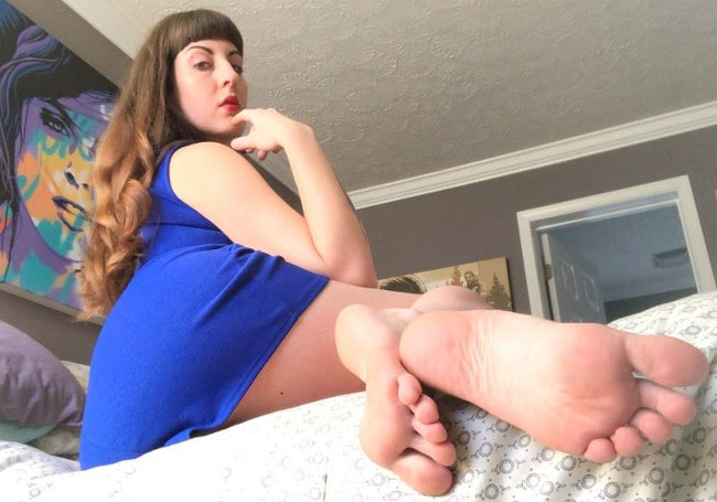 sexy milf poses in blue dress in bare feet