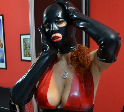 busty redhead findomme in latex mask & gloves
