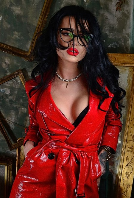 brunette domme modeling red latex outfit