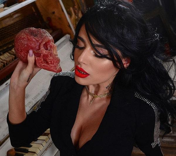 red lipstick mistress flashing cleavage