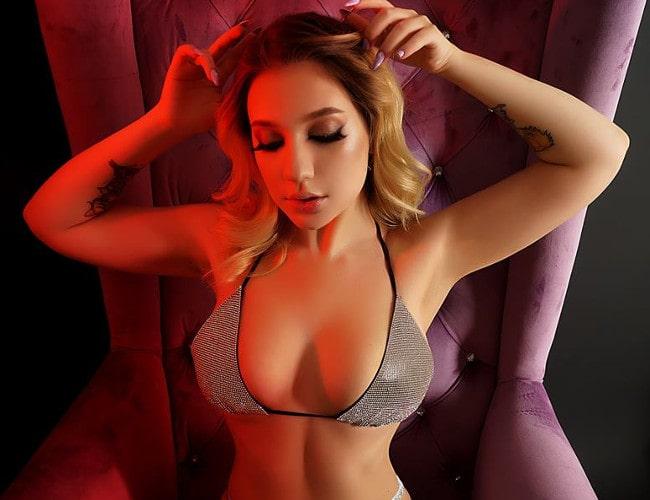 horny blonde domme posing tits in bra