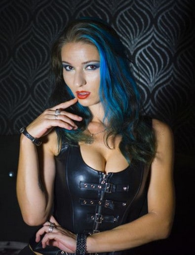 blue-haired findomme leering at camera