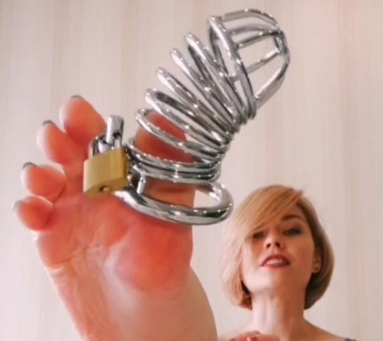 mistress shows the lock for your cock