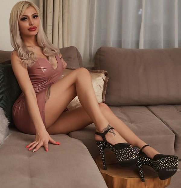 leggy blonde domme teasing long legs in high heels